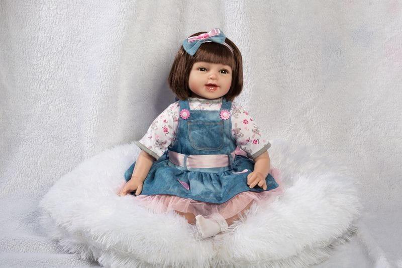 Кукла-пупс REBORN KIDS Аделина - 55 см (в кофточке, шортиках и сарафане, с повязкой на голове)